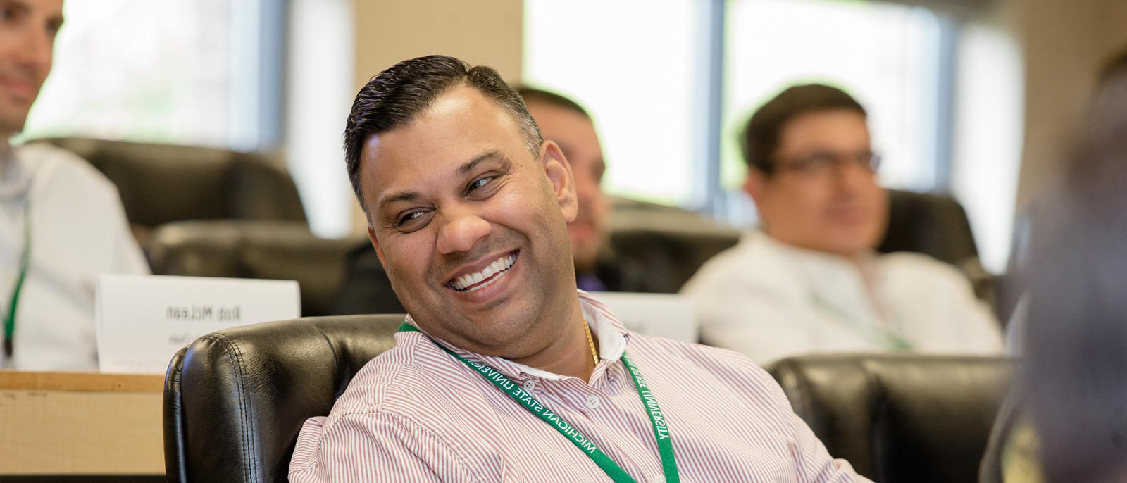 Man smiling while attending an executive development course at MSU